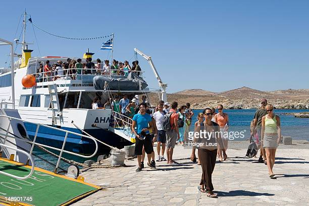 Passengers disembarking from a ferry, Delos, Cyclades Islands.