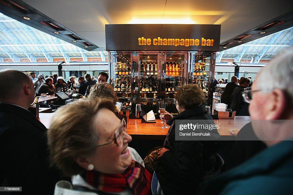 Passengers enjoy a drink at The Champagne Bar at the new St Pancras International Station on November 14 2007 in London England The new St Pancras...