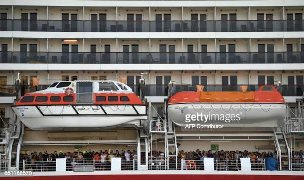Passengers enjoy the views of the Opera House from their cruiseship prior to its departure on a sunny day in Sydney on September 22 2017 Sydney and...
