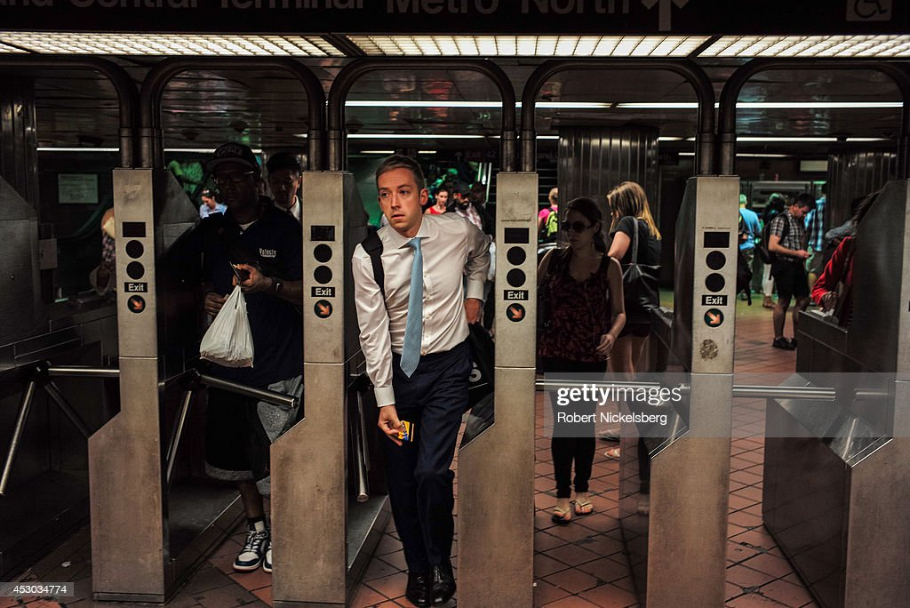 Passengers enter a Metropolitan Transportation Authority subway station July 21, 2014 in the Manhattan borough of New York.