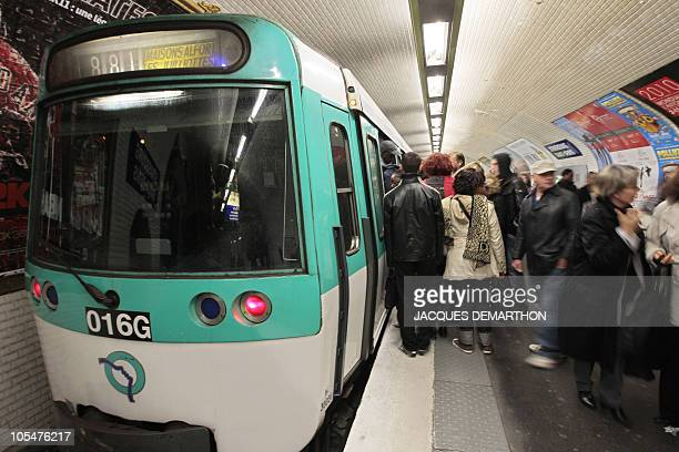 Passengers enter a subway train on October 13 2010 in Paris as striking workers disrupted the French transport system for a second day in their...