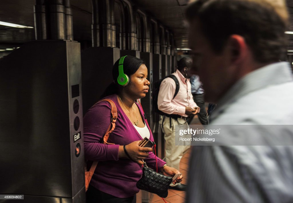 Passengers enter and exit a Metropolitan Transportation Authority subway station July 21, 2014 in the Manhattan borough of New York.