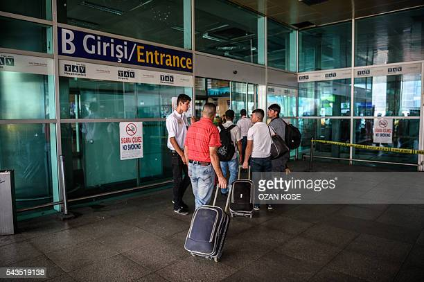 Passengers enter the Ataturk airport International arrival terminal on June 29 2016 a day after a suicide bombing and gun attack targeted Istanbul's...