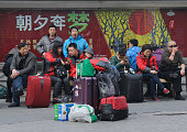 Passengers enter the Beijing West Railway Station on February 14 2015 in Beijing China About 500000 people departed from Beijing on Valentine's Day...