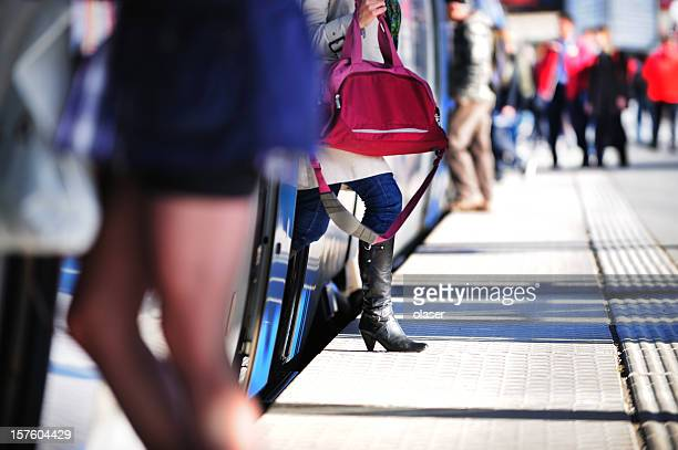Passengers entering and exiting commuter train