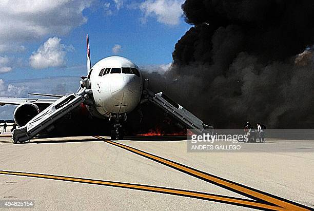 Passengers evacuate from a plane on fire at Fort Lauderdale airport Florida on October 29 2015 An airliner caught fire on a runway at Fort Lauderdale...