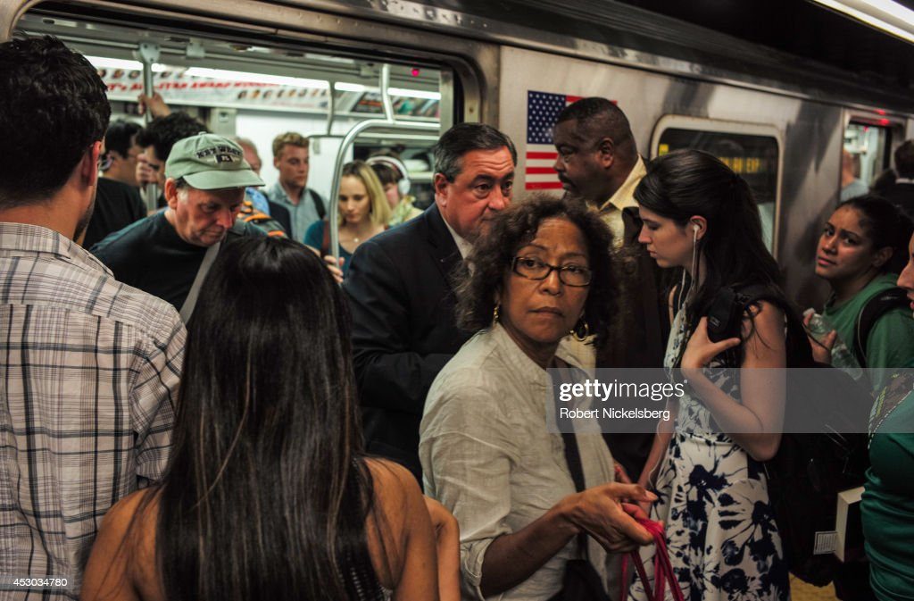 Passengers exit a Metropolitan Transportation Authority subway car July 21, 2014 in the Manhattan borough of New York.