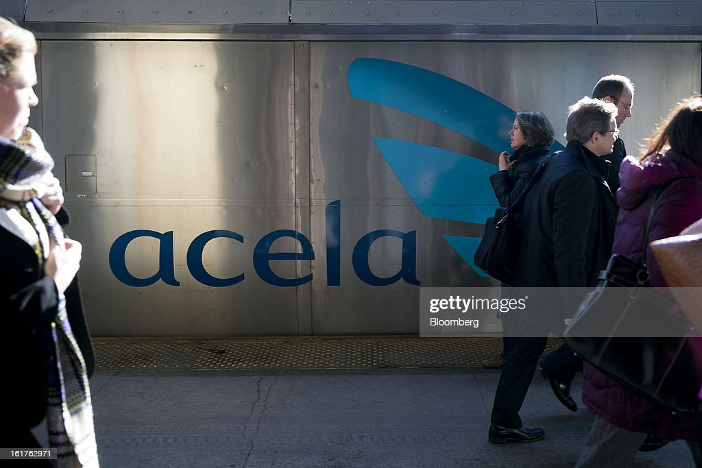 Passengers exit an Amtrak Acela train after arriving at Union Station in Washington, D.C., U.S., on Friday, Feb. 15, 2013. Amtrak, the U.S. long-distance passenger railroad and federally subsidized since its beginning 41 years ago, last month reported its lowest operating loss in nearly four decades, announcing the passenger rail company had reduced its total operating loss by 19 percent compared to the previous year. Photographer: Andrew Harrer/Bloomberg via Getty Images