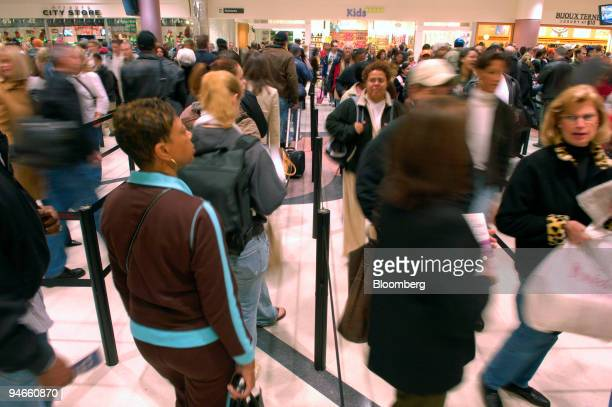 Passengers file through the security checkpoint at HartsfieldJackson International Airport during the busiest day of the travel year November 22 2006...