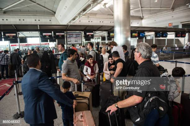 Passengers flying to Arbil wait to checkin for their flight at Ataturk International airport in Istanbul on September 28 2017 All foreign flights to...