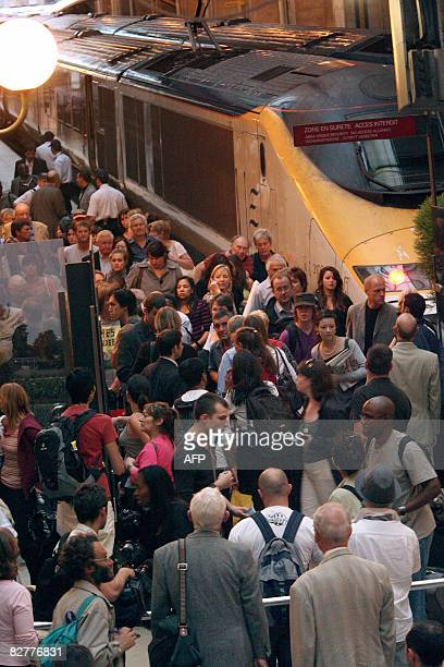 Passengers from the Eurostar blocked in the Channel Tunnel walk on a crowded platform as they arrive on September 11 2008 at Gare du Nord railstation...