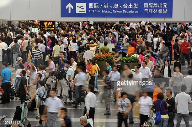 Passengers gather after their flight delays at the Beijing Capital International airport in Beijing on June 17 2010 Thunderstorms wreaked havoc in...