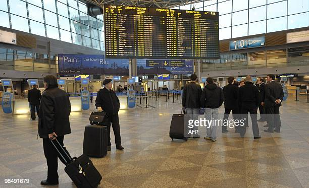 Passengers gather beside an information board at Helsinki Airport on April 16 following the cancellation of flights Flight restrictions due to ash...