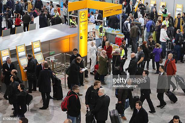 Passengers gather in front of the closed security check at Frankfurt Airport as thousands of travelers are delayed because security personnel are on...