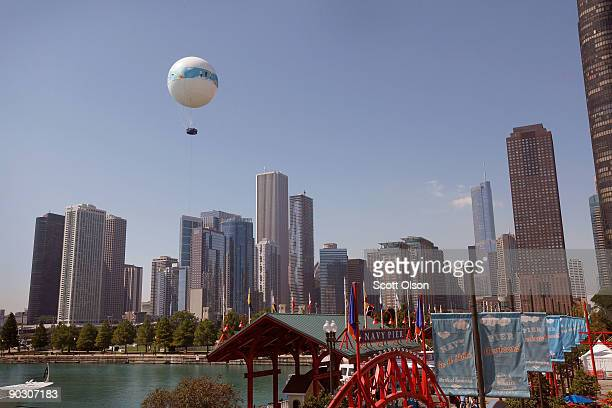Passengers get an aerial view of the city while riding the AeroBalloon at Navy Pier September 2 2009 in Chicago Illinois The heliumfilled balloon...