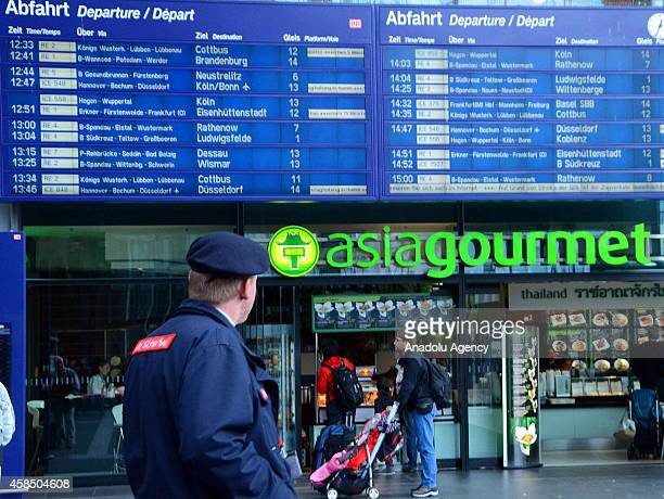 Passengers get informations from the officials in the Berlin main railway station during a fourday strike by the Germany's train drivers' union...