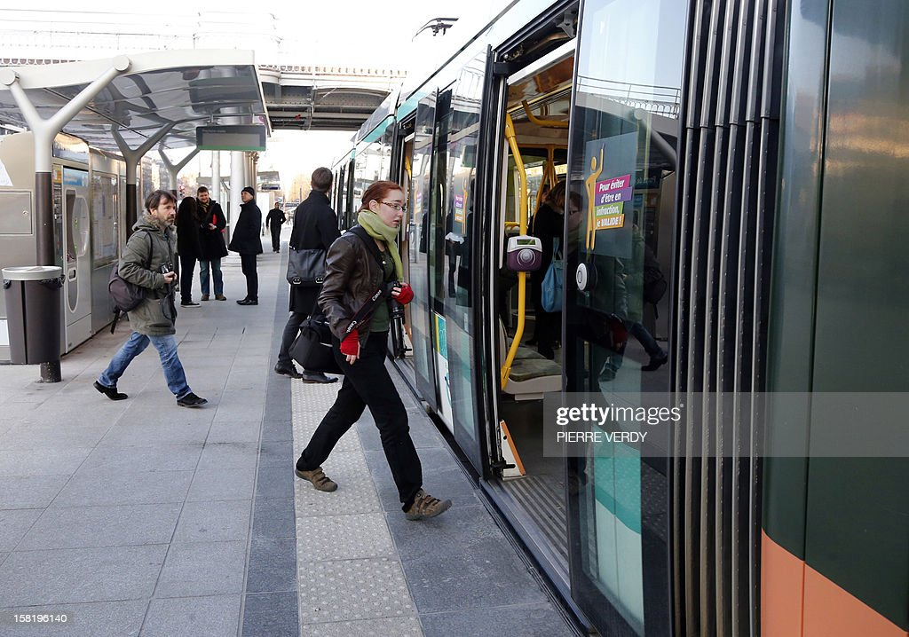 Passengers get into the T3b tramway which operates on a test run from porte de Vincennes to Porte de La Chapelle in Paris, on December 11, 2012, ahead of the inauguration of the route linking the east and the north of Paris' periphery.