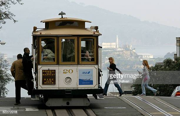 Passengers get on a cable car March 3 2005 in San Francisco California The San Francisco Municipal Railway is proposing to raise the cable car fare...