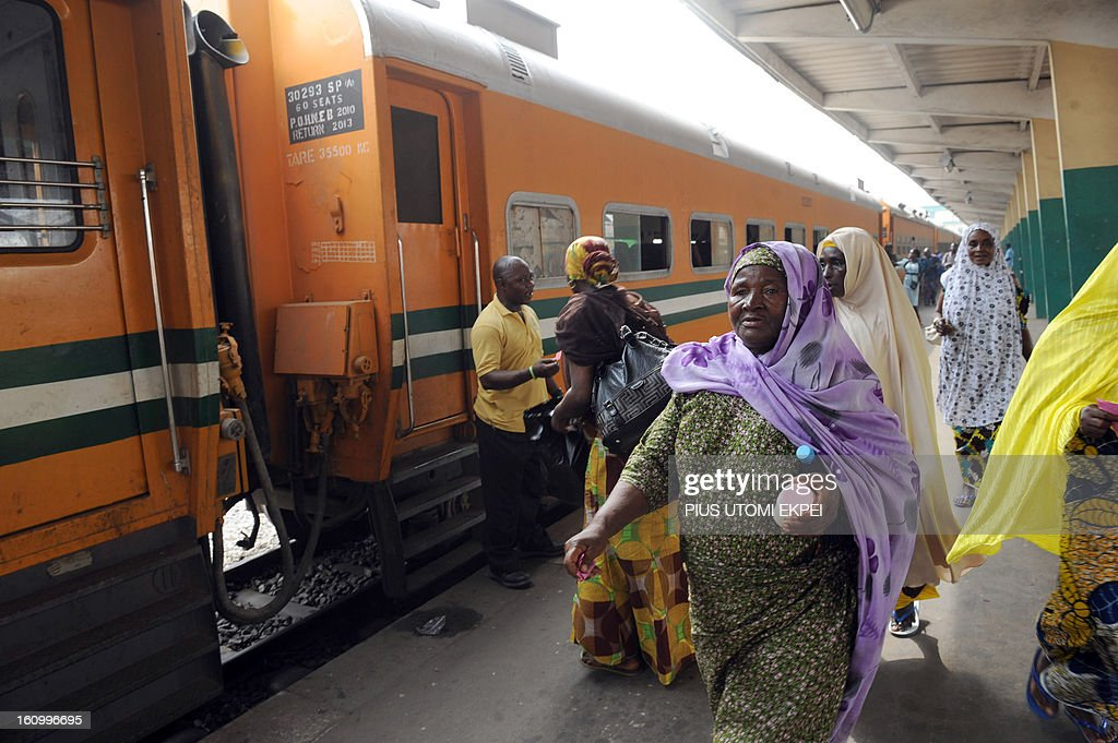 Passengers get ready to board a train at the Lagos Terminus on February 8, 2013. The rejuvenated Nigerian Railway Corporation has commenced operation of mass transit on the Lagos-Kano route, Nigeria's major commercial cities. The state-owned corporation which went into bankruptcy during the last 20 years due to lack of maintenance of infrastructure and high numbers of employees also began haulage of petroleum products from Lagos to the north of the country. Earlier last year, the Railway Corporation had acquired 20 pressurised tank wagons as it prepared to commence the fuel haulage. The 20 wagons have the capacity to lift 900,000 litres of petroleum products, the equivalent of 27 road tankers.