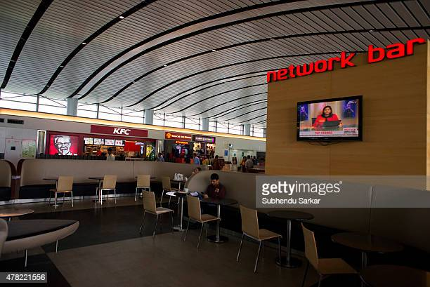 A passengers has coffee while waiting in the lounge at Rajiv Gandhi International Airport in Hyderabad