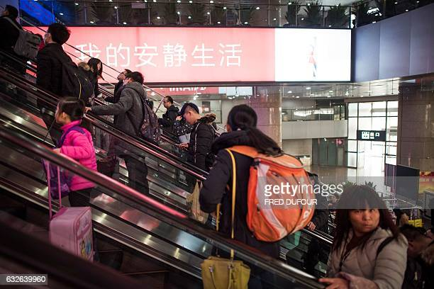 Passengers head back to their hometowns for the 'Spring Festival' or Lunar New Year from Beijing West Railway Station in Beijing on January 25 2017...