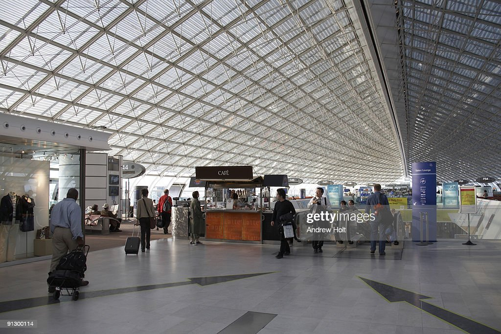 Passengers in Charles De Gaulle Airport : Stock Photo