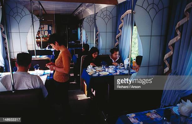 Passengers in dining car on Trans Siberian Railway train.