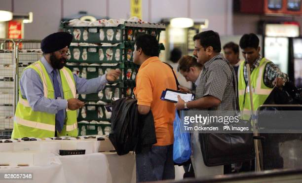 Passengers in Heathrow's Terminal 4 receive food parcels before departing on their flights due to a skrike by Gate Gourmet BA's catering company Gate...