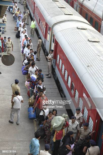 Passengers in long queue to board Shiv Ganga Express train which runs from New Delhi to Varanasi who wanted to go to their native place for the...