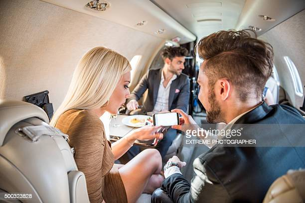 Passengers in private jet airplane