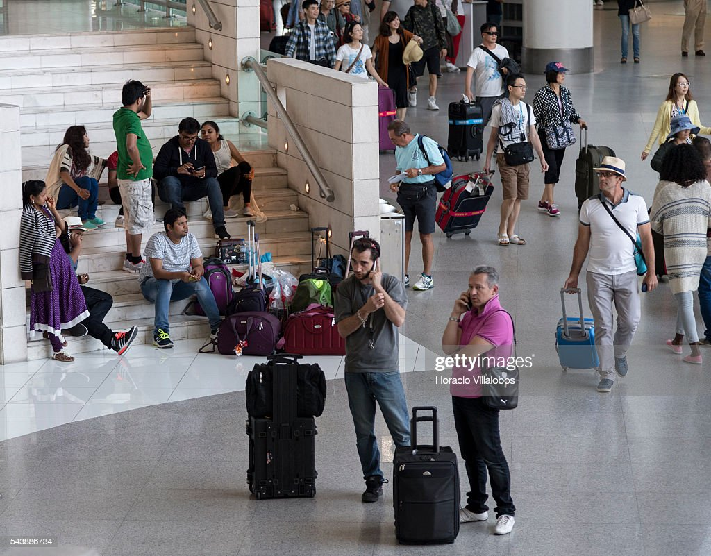 Passengers in Terminal 1 of Lisbon Humberto Delgado Airport in a business as usual day after air controllers called off their strike action on June 30, 2016 in Lisbon, Portugal. Although controllers cancelled their labor protest, the airport will suffer a three-days strike, starting on July 1st, staged by luggage handlers, that is supposed to cause a grave disruption.