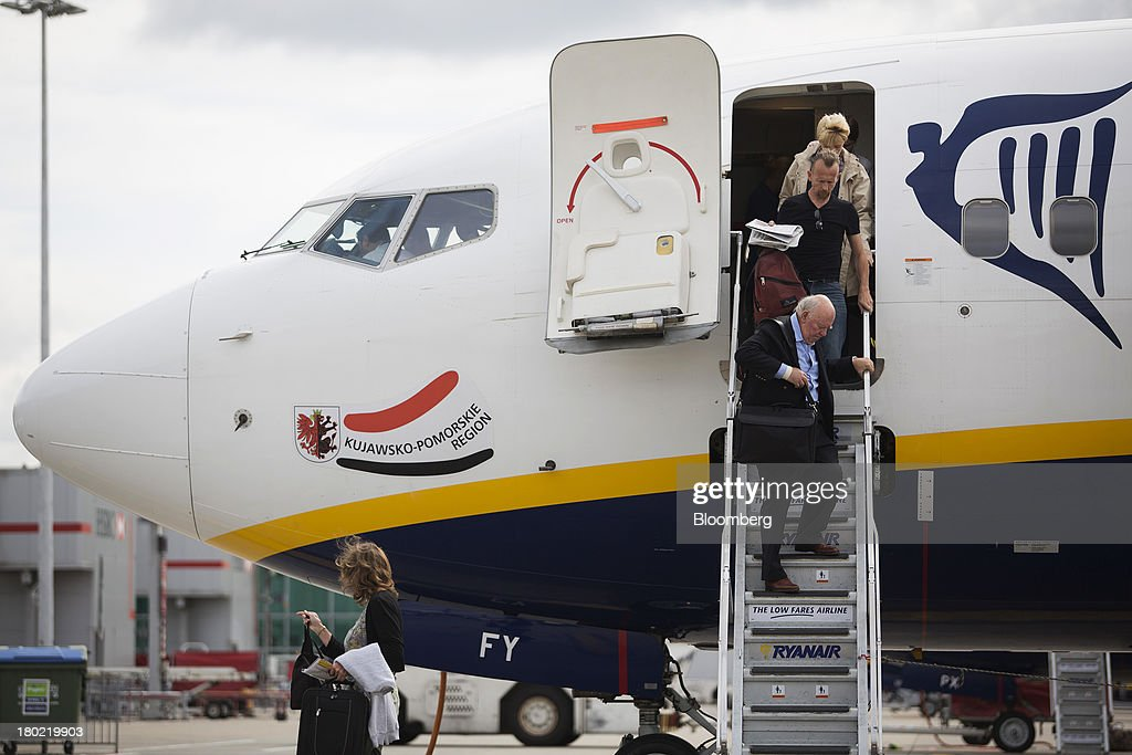 Passengers leave a Ryanair Holdings Plc aircraft using the front steps at Stansted Airport, operated by Manchester Airports Group (MAG) in Stansted, U.K., on Tuesday, Sept. 10, 2013. From two planes in 1995, EasyJet has grown to more than 200 Airbus SAS aircraft carrying more than 59 million people annually, 20 million fewer than Ryanair. Photographer: Simon Dawson/Bloomberg via Getty Images