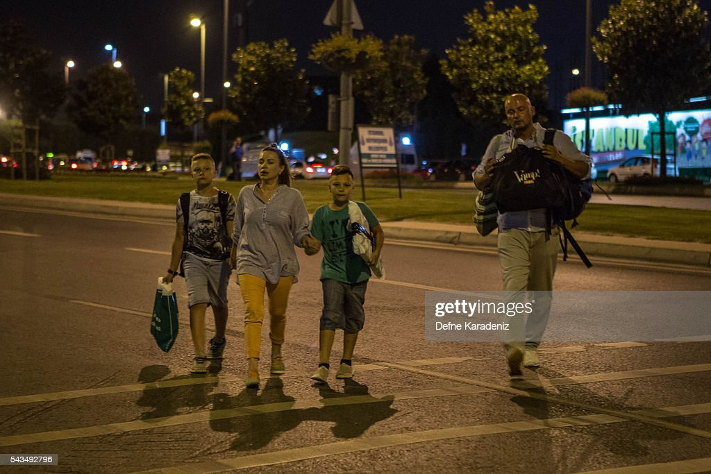 Passengers leave Istanbul Ataturk, Turkey's largest airport, after a suicide bomb attack in the early hours of June 29, 2016, Istanbul, Turkey. Three suicide bombers opened fire before blowing themselves up at the entrance to the main international airport in Istanbul, killing at least 28 people and wounding at least 60 people according to Istanbul governor Vasip Sahin.
