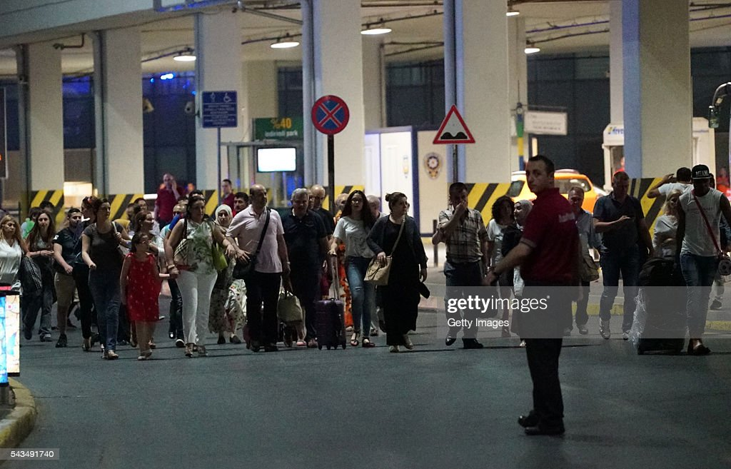 Passengers leave the Turkey's largest airport, Istanbul Ataturk, after the suicide bomb attack on June 28, 2016 in Istanbul, Turkey. Three suicide bombers opened fire before blowing themselves up at the entrance to the main international airport in Istanbul, killing at least 28 people and wounding at least 60 people, according to Istanbul governor Vasip Sahin.