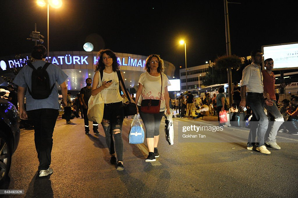 Passengers leave the Turkey's largest airport, Istanbul Ataturk after the suicide bomb attacks, June 28, 2016, Turkey. Three suicide bombers opened fire before blowing themselves up at the entrance to the main international airport in Istanbul, killing at least 28 people and wounding at least 60 people according to Istanbul governor Vasip Sahin.