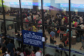Passengers line to refund tickets at Beijing West Railway Station as many railway line are halted due to heavy rainstorm on July 20 2016 in Beijing...