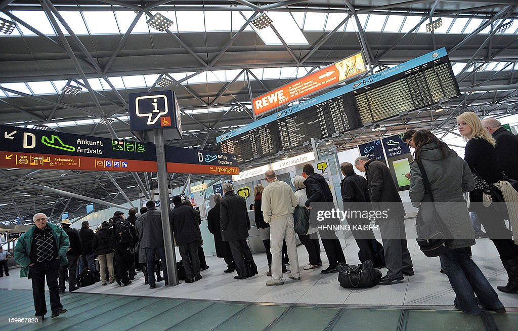 Passengers line up at the airport in Cologne, western Germany, on January 24, 2013. Security staff at the airport staged a strike to demand higher pay, leading to the cancellation of flights.