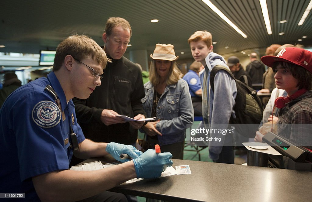 passengers line up to a transportation security administration tsa officer to go through airport - Transportation Security Officer