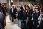 Passengers line up to get on a bus near Waterloo Station on September 7 2010 in London England Disruption to the capital's commuters is expected...