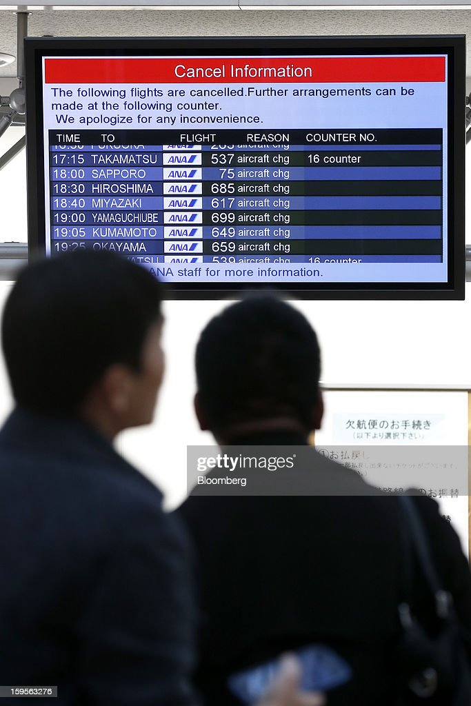 Passengers look at a cancellation notice of All Nippon Airways Co. (ANA) flights at Haneda Airport in Tokyo, Japan, on Wednesday, Jan. 16, 2013. ANA and Japan Airlines Co. (JAL), the world's largest users of Boeing Co. 787 jets, grounded their entire fleet of Dreamliners for today in the biggest blow yet to the troubled passenger jet's image. Photographer: Kiyoshi Ota/Bloomberg via Getty Images
