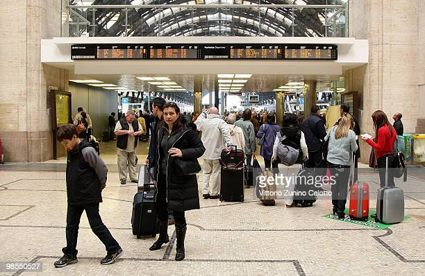 Passengers look at the departures board at Milano Centrale train station on April 19 2010 in Milan Italy Passengers are looking for alternative...