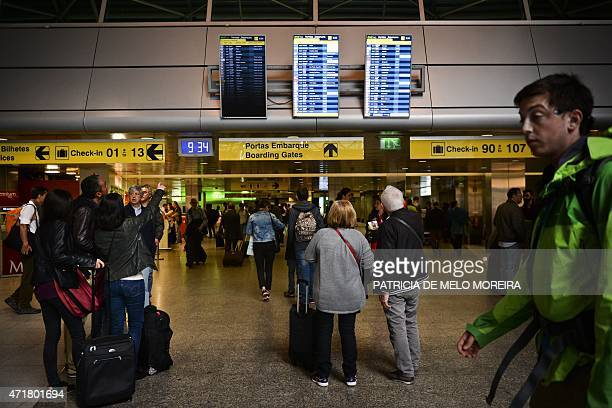 Passengers look at the departures screens at Lisbon's Airport during a pilots strike on May 1 2015 Portuguese stateowned airline TAP pilots staged a...