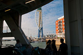 Passengers look at the Spinnaker Tower in Portsmouth harbour from the Wightlink ferry arriving from the Isle of Wight on July 23 2016 in Portsmouth...