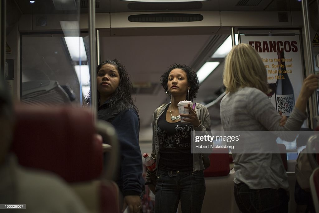 Passengers look for seats on board a Metro North train heading to New York's Grand Central Station November 11, 2012 in southern Connecticut.