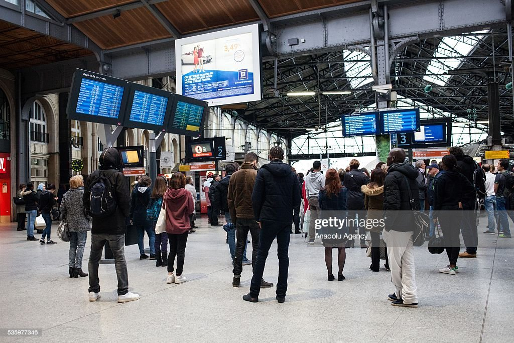Passengers look for the information about delayed or cancelled trains as strikes affect public transport at Paris Saint-Lazare Train Station, Paris, France on May 31, 2016.