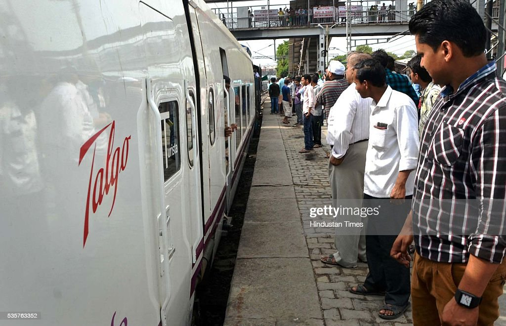 Passengers looking at Spanish train Talgo at Bareily railway station during its first trial run between Bareilly and Moradabad on May 29, 2016 in Bareilly, India. The trial of Spanish train Talgo, the lighter and faster vehicle with speed up to 115 km per hour, was conducted between Bareilly and Moradabad in Uttar Pradesh as part of the Railways' strategy to increase the speed of trains. Nine Talgo coaches were hauled by a 4,500 HP diesel engine on the 90-km line for the first trial run.