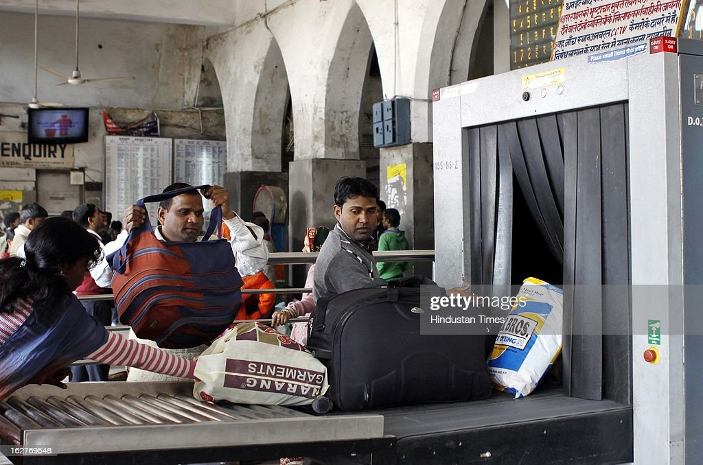 Passengers luggage passes through the X Ray machine at old Delhi Railway station on February 26, 2013 in New Delhi, India. Indian Railway Minister Pawan Kumar Bansal presented his maiden Railway budget for the next fiscal year in the parliament.