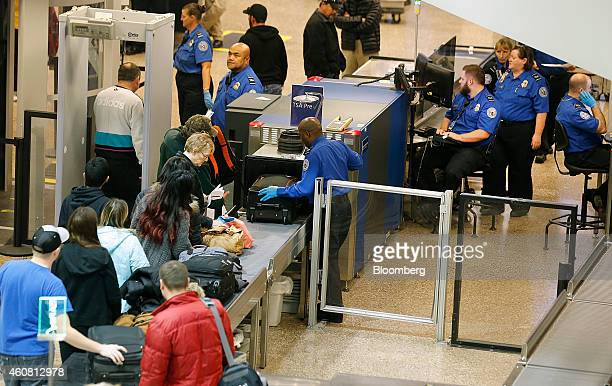 Passengers make their way through a Transportation Security Administration check point at Salt Lake City International Airport in Salt Lake City Utah...