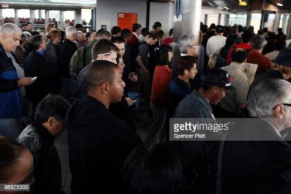 Passengers make their way to a ferry headed to Manhattan following the crash of the Staten Island Ferry into a dock in the city's borough of Staten...