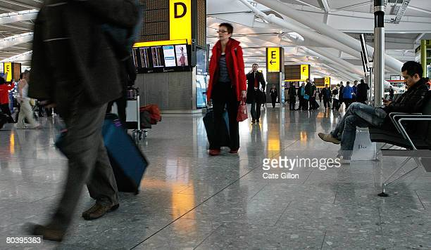 Passengers make their way to checkin in the departures area of Terminal 5 on March 27 2008 in London England Terminal 5 opens to the public for its...